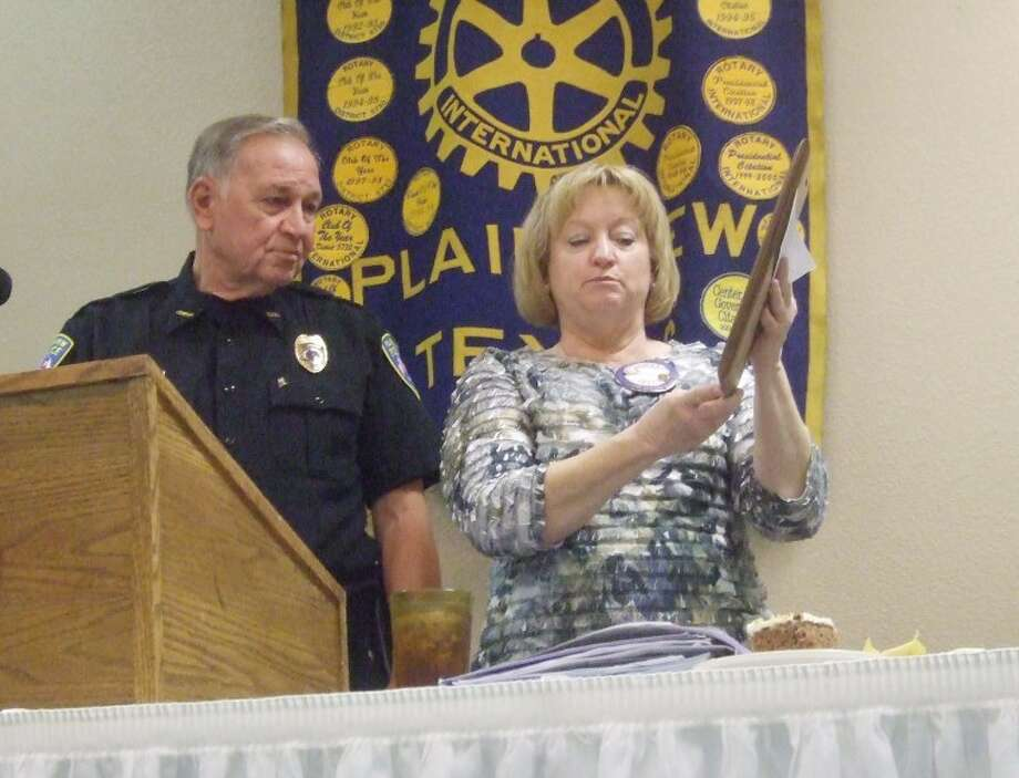 Jessica Thornton/Plainview HeraldPolice Chief Will Mull accepts the Citizenship Award from Plainview Rotary Club President Coralyn Dillard. The club recognized Plainview's first responders.