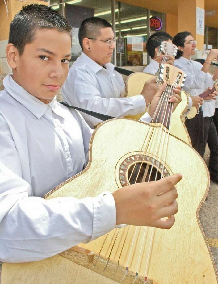 Gordon Zeigler/Plainview HeraldProviding a treat targeted at mothers and their families in front of La Super Economica grocery store is the group Mariachi Sangre Joven of Lubbock. They were engaged by the store to serenade shoppers on Saturday ahead of Mother's Day. Playing a traditional guitarrón — a slightly oversized version of a guitar — is A.J. Jimenez (left) along with Marcus Mendoza, Allen Martinez and trumpeter Junior Torres.