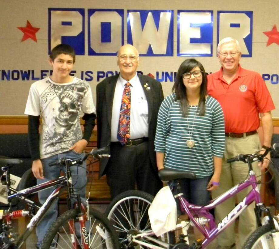 Courtesy PhotoWinning new bikes in the Plainview Rotary Club's perfect attendance program were Ash students Justin Rodriguez and Samantha Gutierrez. The bikes were presented by Max Browning (second from left) and Charles Starnes. The program is conducted at PISD secondary campuses.