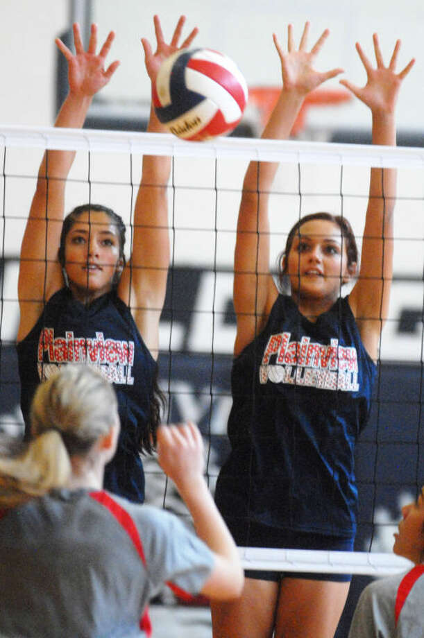 Plainview volleyball players put up a big block during their first scrimmage of the season Friday. Photo: Skip Leon/Plainview Herald