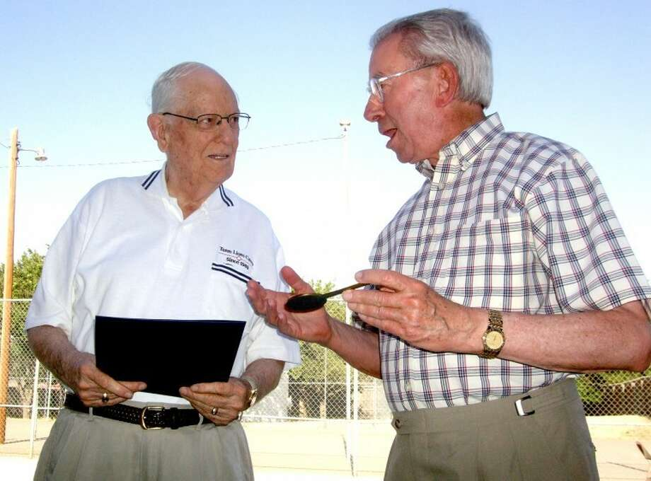 "Tut Tawwater (left) was honored for 60 years of perfect attendance in the Plainview Lions Club at a hamburger supper Thursday night. Here, Mayor John C. Anderson presents Tawwater with a key to the city after proclaiming Thursday as Tut Tawwater Day. The 88-year-old said he was drawn into the Lions Club by their fellowship and good works. ""I put Wednesday noon on my calendar (to attend meetings), and after awhile I didn't need to have it on my calendar. I automatically went."" Tawwater, who credited his wife of almost 68 years, Dorothy, for her encouragement, has missed a few meetings through the years, but Lions are able to make up for absences through volunteer service. Tawwater is a past local president, district governor and state council chair."