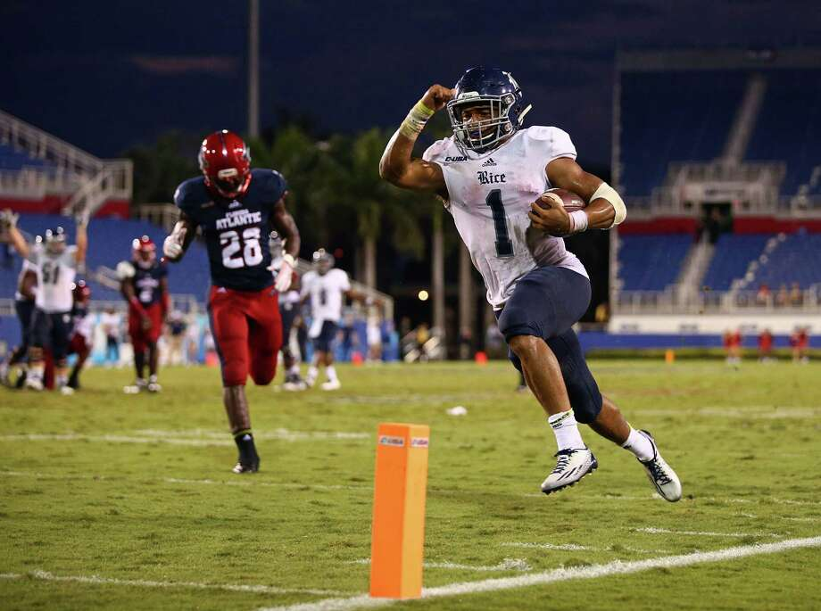 Darik Dillard of the Rice Owls scores the game-winning touchdown as Alfred Ansley of the Florida Atlantic Owls looks on during the fourth quarter of the game at FAU Stadium on Oct. 10, 2015 in Boca Raton, Fla. Photo: Rob Foldy /Getty Images / 2015 Getty Images