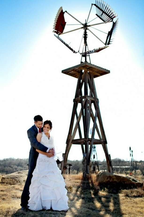 Aric+Casey PhotograhyAlston Becker and Jesalyn Bradley's weddingphotographs were taken at the American Wind and Power Center andMuseum in Lubbock where their reception was held Dec. 18, 2010.They were married at St. Paul's Chapel in Lubbock.