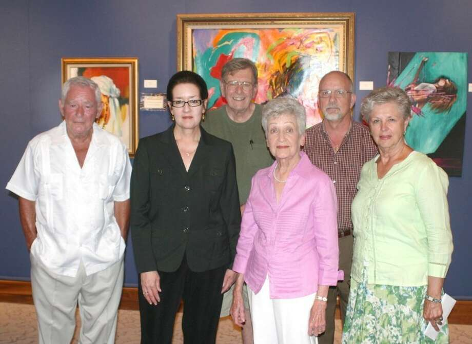 Jonathan Petty/Wayland Baptist UniversityThe Plains Art Association held its awards reception Sunday afternoon in the Malouf Abraham Art Gallery on the campus of Wayland Baptist University. Pictured are the first place and major award winners: Carlos Jordan (front left), Best Concept of Color and Light; Dr. Candace Keller, watercolor; May Tom Tooley, oils; Cynthia Pinnell (back left), Best of Show; Tom Higley, photography; and Rick Wallace, first in other art forms/miniatures.