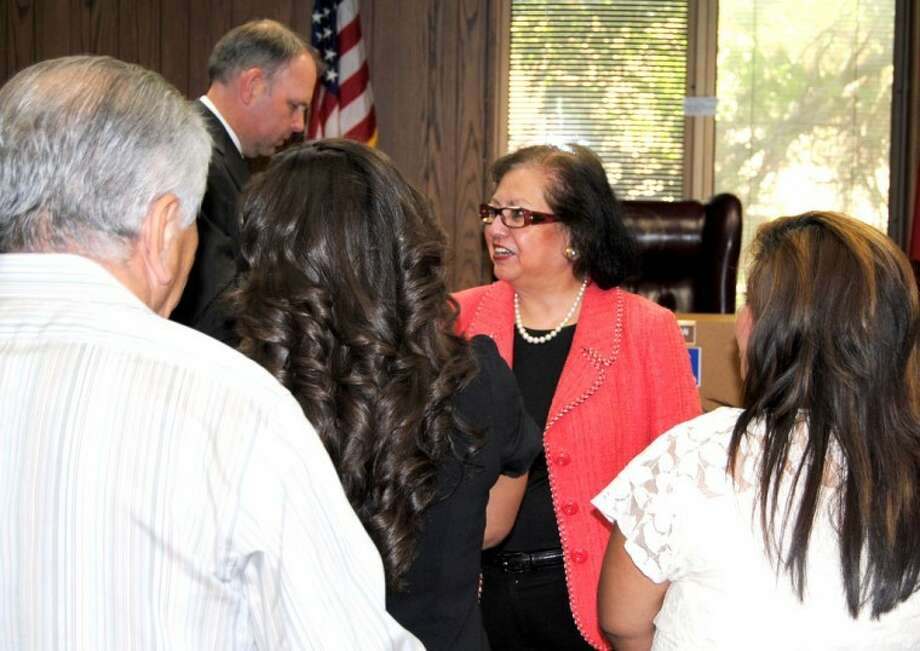 Texas Secretary of State Hope Andrade visited the Hale County Courthouse on Friday as part of her statewide campaign to encourage voting. In the background is Andrade's director of communications, Rich Parsons.