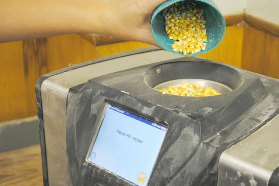 A grain moisture machine being demonstrated at Plainview Grain Inspection.