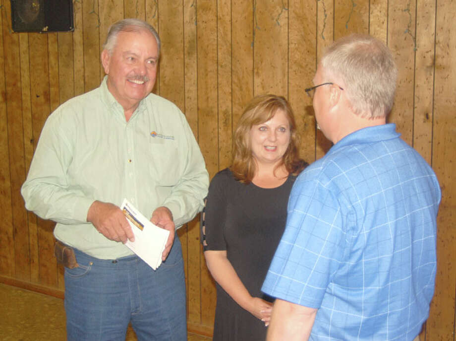 Ports-To-Plains Alliance Vice Chairman Milton R. Pax (left) of Dumas and Vice President Duffy Hinkle of Lubbock visit with Paul Henderson on Wednesday after Hinkle updated Plainview Lions on the group's progress. Photo: Doug McDonough/Plainview Herald