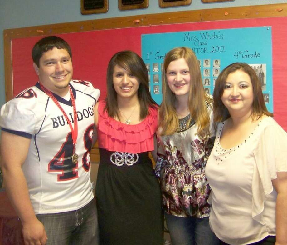 Janet Bontke/Highland ElementaryPlainview High School seniors Kyle Griego (left), Desiree Villarreal and Rebecca Owens received the Highland PTA Jacob Chapa Memorial Scholarship. PTA President Geneva Garcia presented the students with their scholarship and with a writing pen carved from the old wooden floor in the principal's office.
