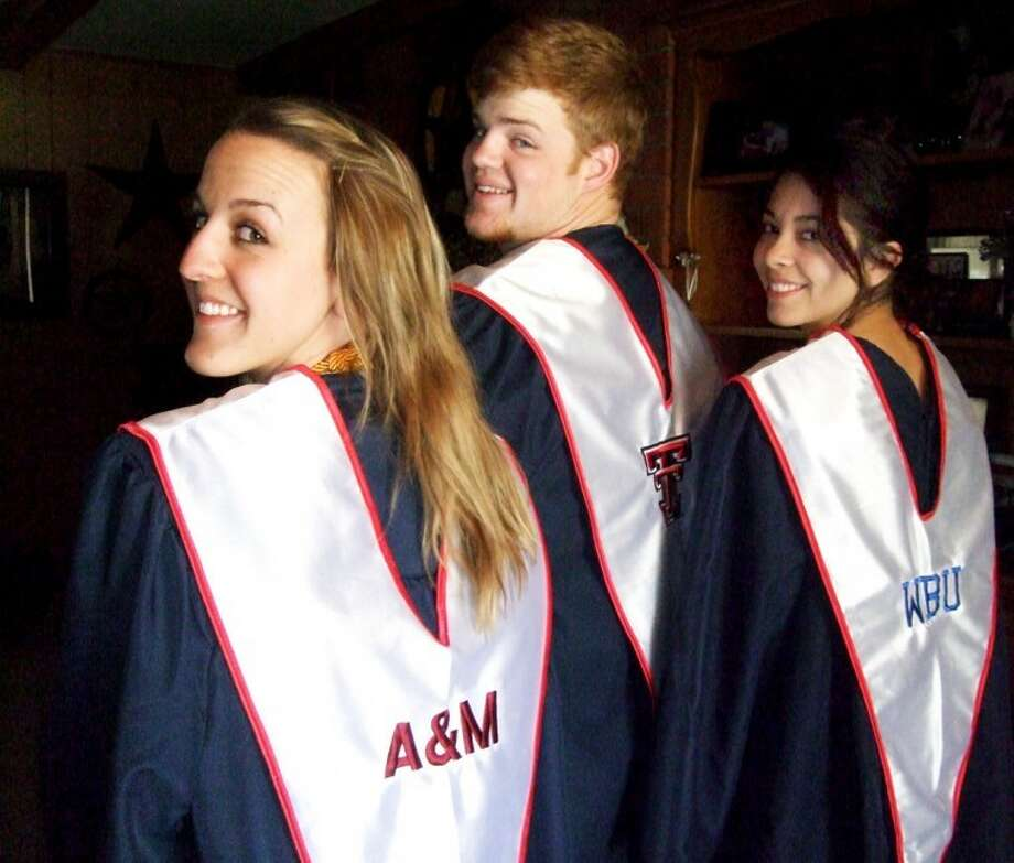 Kevin Lewis/Plainview HeraldPHS seniors Michaela Gilleland (left), Drew Dunlap and Sarah Patrick model their commencement attire, complete with the initials or logo of the college they plan to attend. Commencement exercises will be held at 7 p.m. Friday in Wayland's Hutcherson Center.