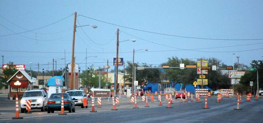 Local motorists are now facing an obstacle course of sorts along Fifth Street/Olton Road as construction gets under way. Traffic cones have narrowed the normal four lanes of traffic down to two and traffic lights at major intersections are now flashing red in all four directions. Photo: Doug McDonough/Plainview Herald