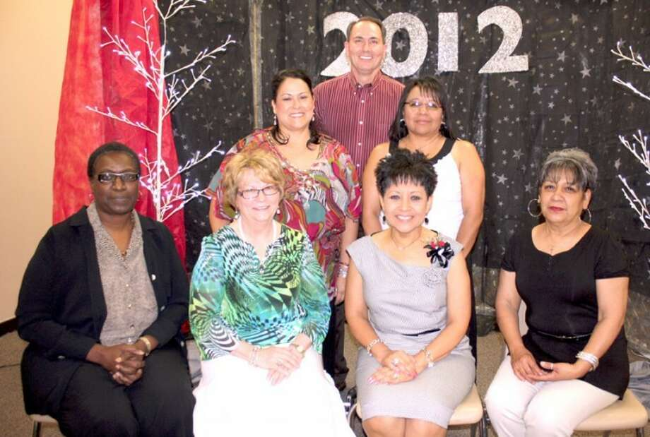 Jan Seago/Plainview ISDEmployees honored for long-term service were Marilyn Jennings, 35 years (seated, left); Linda Eversole, 30; Angie Valdez, 25; Mabel Caballero, 25; Pat Hill, 25 (center, left); Ana Landeros, 30; and Kerry Sarchet, 25. Not shown are Susan Blackerby, 25; Judy Dwyer, 25; Danny Wrenn, 25; and Barbara Ramirez, 30.