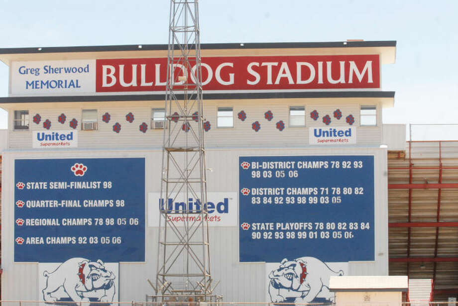 The front of Bulldog Stadium displays the rich history of Plainview High School football. Much of it began with the 1978 team, which was the first squad to win an outright district championship, a bi-district championship, a regional championship and the first to qualify for the state playoffs. In addition, the name of that team's coach, Greg Sherwood, also is on the front of the stadium. Photo: Skip Leon/Plainview Herald