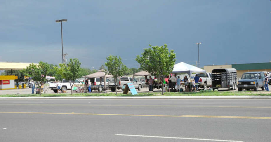 Threatening skies didn't close down vendors or keep customers away from Mid-Plains Farmers Market in Gebo's parking lot Thursday afternoon. Photo: Gail M. Williams | Plainview Herald