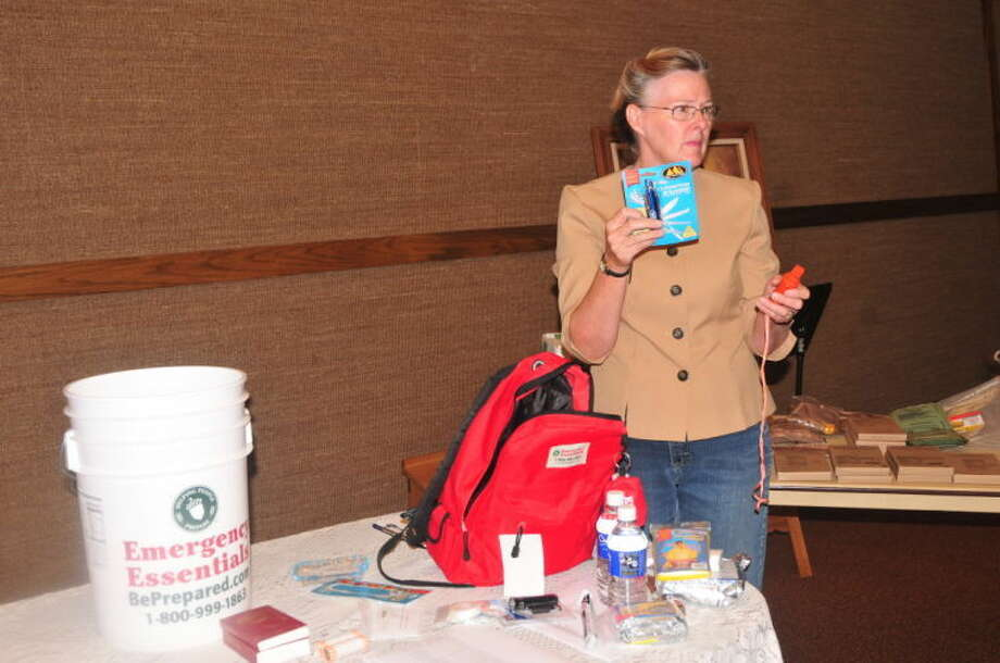 Relief Society councilor Janice Sharp shows the contents of a 72-hour survival backpack during a meeting at the Church of Jesus Christ of Latter-Day Saints. Photo: Homer Marquez/Plainview Herald