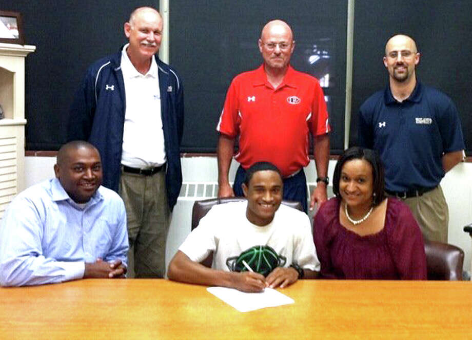 Plainview Bulldog Jaylon Jackson (front, middle), a three-time all-district player who was second-team all-South Plains last season, signed an agreement Monday to play basketball at Wayland Baptist University. On hand for the occasion were Jackson's parents, Andrew and Rhonda Jackson, and (back, from left) Wayland assistant Jeff Tuckness, PHS coach Leon Hagerman and WBU head coach Matt Garnett. (See story in Wednesday's Herald.)