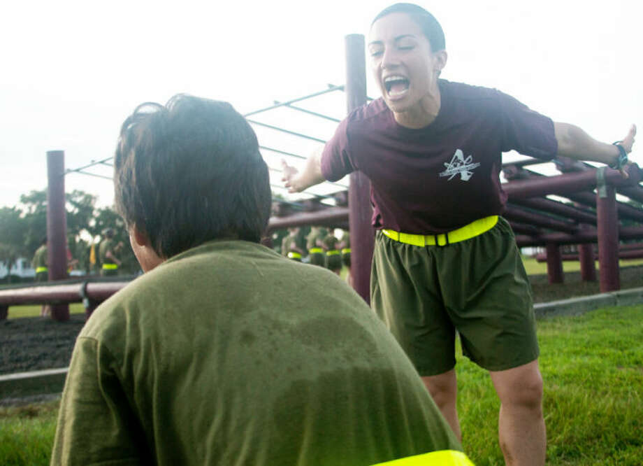 "Sgt. Britni Garcia Green currently serves as a Marine Corps drill instructor with November Company, 4th Recruit Training Battalion, at Marine Corps Recruit Depot Parris Island, S.C. Garcia Green joined the Marine Corps in September 2007 and became a drill instructor in April 2013. Garcia Green is a native of Tulia, Texas. ""I wanted to challenge myself. I didn't want to wonder later if I could have been a drill instructor,"" said Garcia Green. About 600 Marine Corps drill instructors shape the approximately 20,000 recruits who come to Parris Island annually into basic United States Marines. Parris Island is home to entry-level enlisted training for 50 percent of males and 100 percent for females in the Marine Corps. (Photo by Lance Cpl. MaryAnn Hill) Photo: Lance Cpl. MaryAnn Hill"
