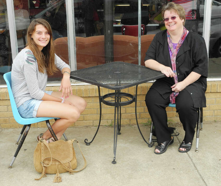 Gail M. Williams/Plainview HeraldGabrielle Chargy, 16, an exchange student from Niort, France, sits with her host Karen Hawkins at a sidewalk table outside The Broadway Brew. Gabrielle is part of the Rotary Youth Exchange program.