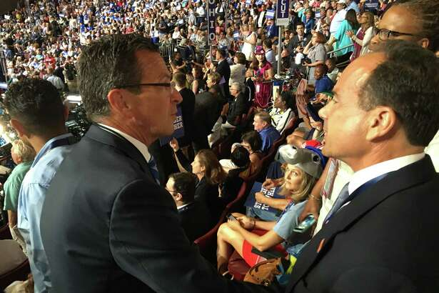 Gov. Dannel P. Malloy, left, and Bridgeport Mayor Joe Ganim come together Monday during the Democratic National Convention in Philadelphia.