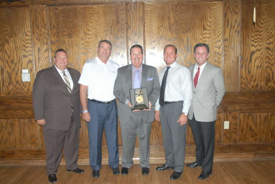 Plainview's Reagor-Dykes dealership was presented its second consecutive President's Award from the Toyota Company. Pictured from left are Brett Brown, Rick Dykes, Eddie Ashburn, Bart Reagor and Dale Hall. Photo: Homer Marquez/Plainview Herald