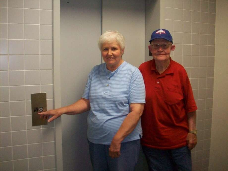 Courtesy PhotoRSVP volunteers Sally and Leon Phillips are ready to step on the elevator leading to the new RSVP offices in the basement at Unger Memorial Library. The offices are accessible by stairs near the front door of the library or the elevator and a spiral staircase at the rear of the building. Photo: Picasa