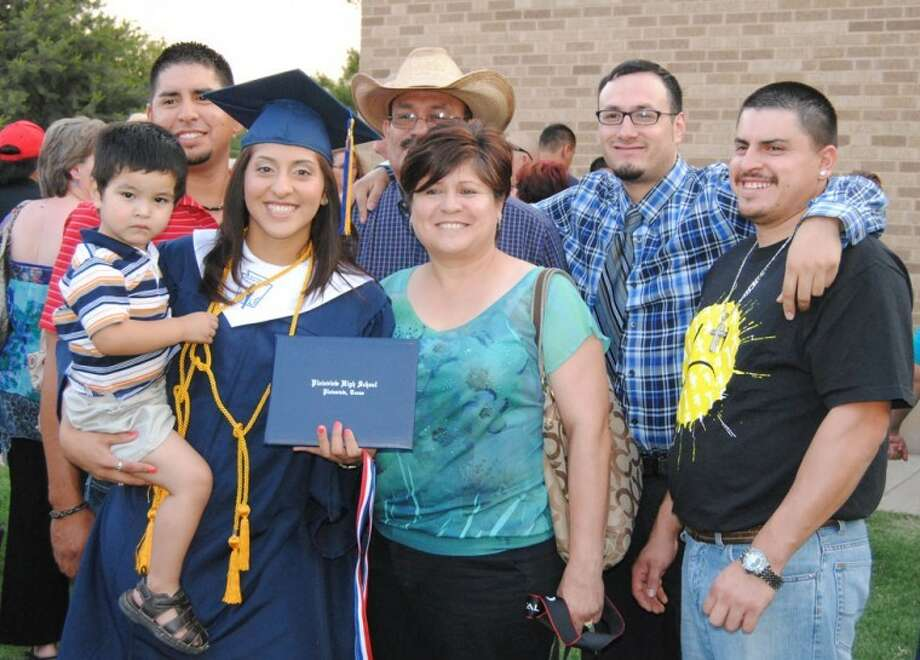 Doug McDonough/Plainview HeraldLaura Castillo poses with family members outside Hutcherson Center following commencement.
