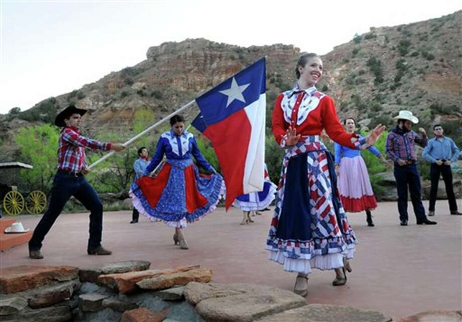"In this May 21, 2013 photo, ""Texas"" cast members rehearse on stage at the Pioneer Amphitheatre in Palo Duro Canyon, Texas. Five cast members of the musical were killed in an automobile accident Monday night, Aug. 12, 2013 near Dumas, Texas, said Christopher Ray, a Texas Department of Public Safety spokesman. (AP Photo/Amarillo Globe-News, Sean Steffen) Photo: Sean Steffen / Amarillo Globe-News"