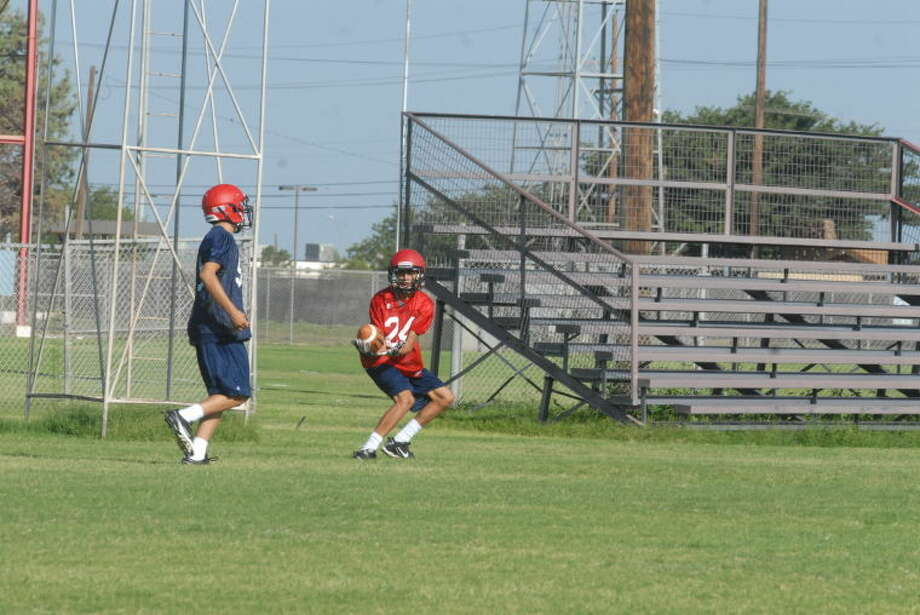 A Plainview receiver catches a pass during an early-season practice. The Bulldogs have their first scrimmage Saturday against Perryton and Lubbock Estacado. Photo: Skip Leon/Plainview Herald