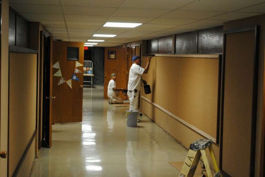 Workers paint the walls of Hale Center's Akin Elementary after a summer fire in the school's gym damaged much of the building. Photo: Ryan Crowe/Plainview Herald