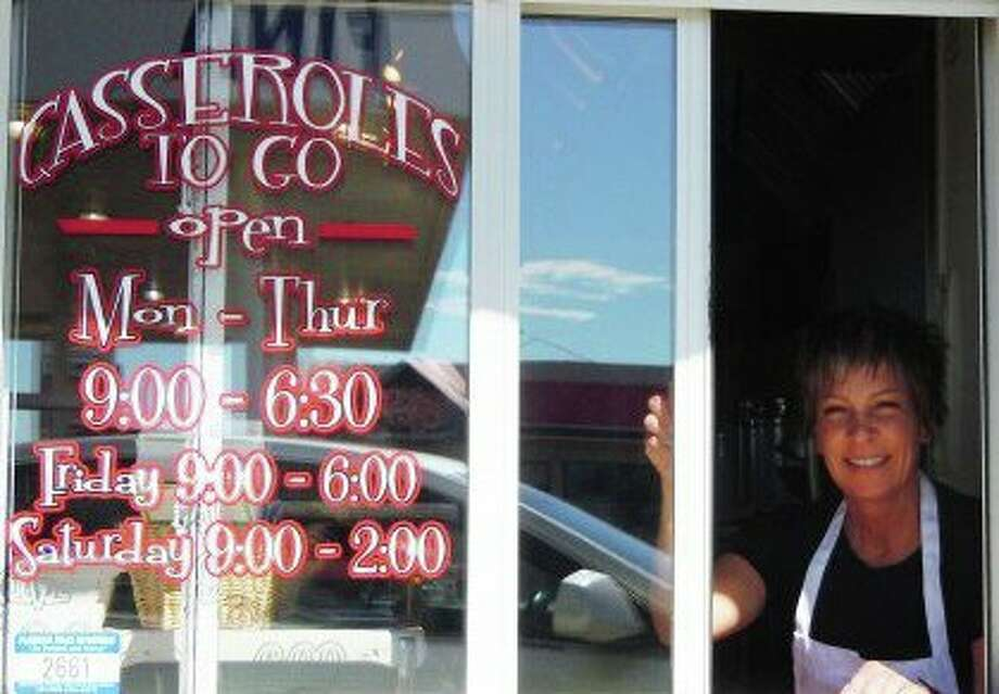 "Courtesy PhotoJanet Smith at the take out window at Casserolesto Go., which was listed in Texas Monthly's Dining feature in theJuly 2011 issue. Smith started the business in 2001, then movedinto the ""cute little wink of a kitchen"" (Texas Monthly, page 131)in 2006."