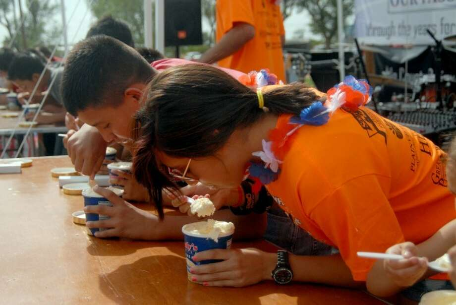 Emily Flores (front) competes in the 16-and-under Ice Cream Eating Contest at Monday's Red, White and Moo Milk Fest. Photo: Richard Porter/Plainview Herald