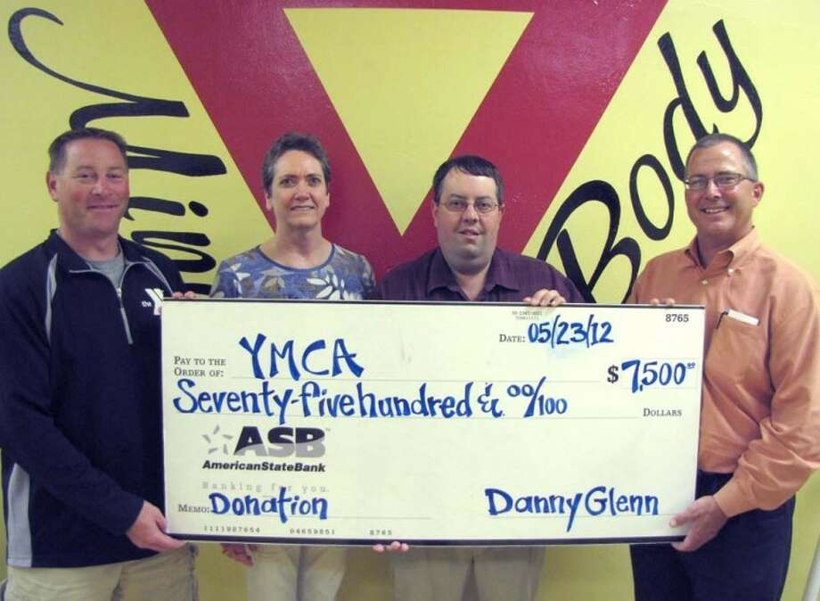 Courtesy PhotoYMCA Senior Program Director Mike Finley (left), Operations Director Karen Crim and Executive Director Rob Wilkinson accept a $7,500 donation from ASB Branch President Danny Glenn. The funds will be used to buy exercise equipment for a branch YMCA scheduled to open in Tulia this fall.