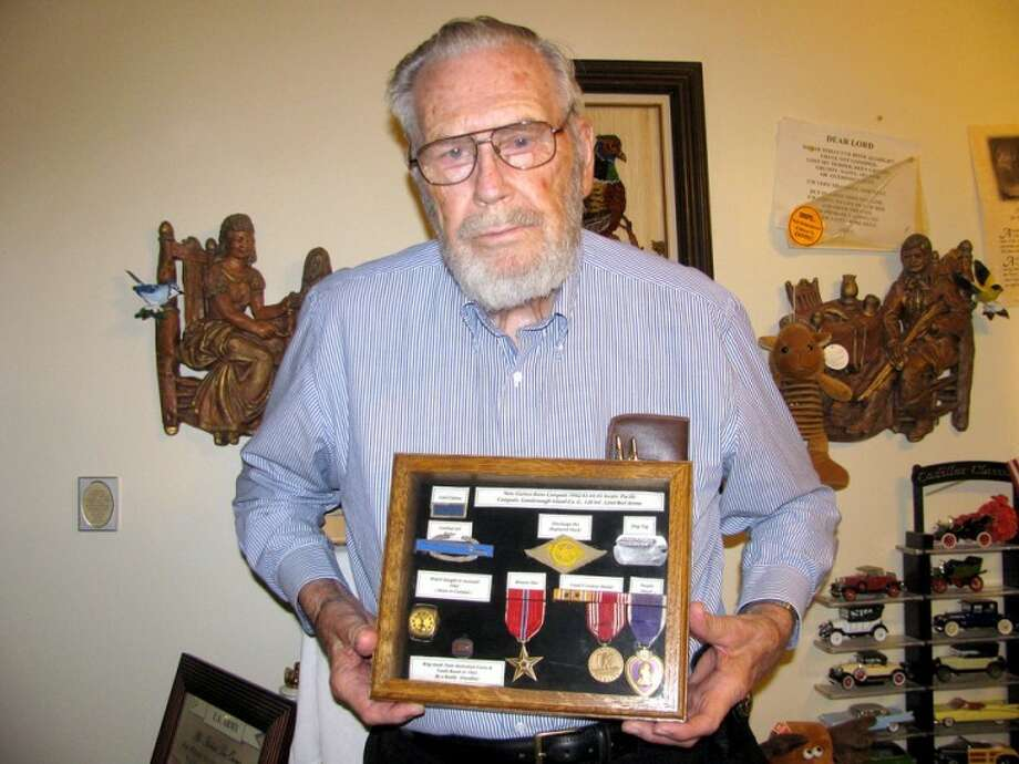 R.L. Owens of Plainview shows some of the medals he was awarded during his time in the U.S. Army during World War II. Photo: Laurelin Ontai Plainview Herald