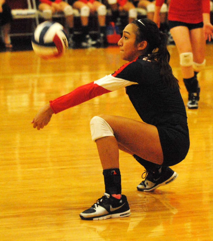 Lupita Quintanilla digs out a hit by Tulia in a volleyball match earlier this season. Quintanilla had 40 digs in three matches at the Copperas Cove Tournament Friday. Photo: Skip Leon/Plainview Herald