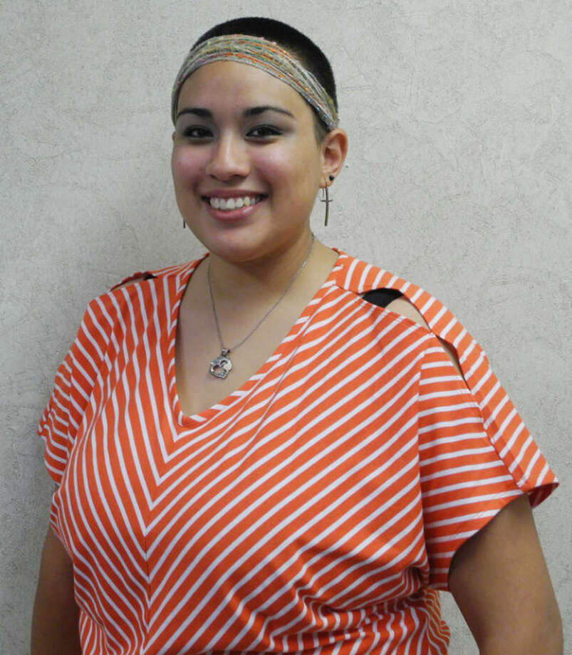 Ashley Robles, 19, recently donated her hair to Locks of Love in memory of her cousin Brittini Lopez who died of cancer at age 19. Photo: Gail M. Williams | Plainview Herald