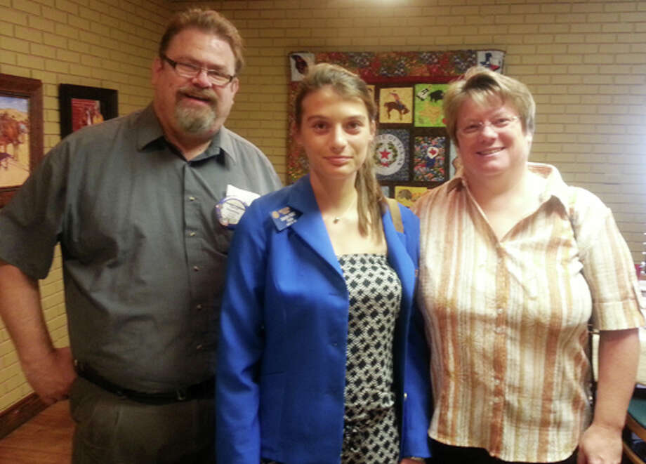 Gabrielle Chargy of Niort, France, is shown with her host parents Dave and Karen Hawkins at the Plainview Rotary meeting. The Rotary is holding a bowling tournament/fundraiser for the Rotary Youth Exchange program from noon to 2 p.m. Saturday, Aug. 24, at Plainview Bowling Center. Photo: Courtesy Photo