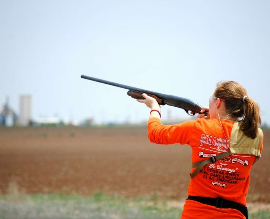 Doug McDonough/Plainview HeraldHeather Bozeman takes aim while awaiting a clay pigeon during 4-H trap shooting practice. Members of Hale County 4-H shooting sports practice shooting clay pigeons each Sunday to prepare for district competition in late June. Their range is located west of Cargill Meat Solutions off County Road 50.