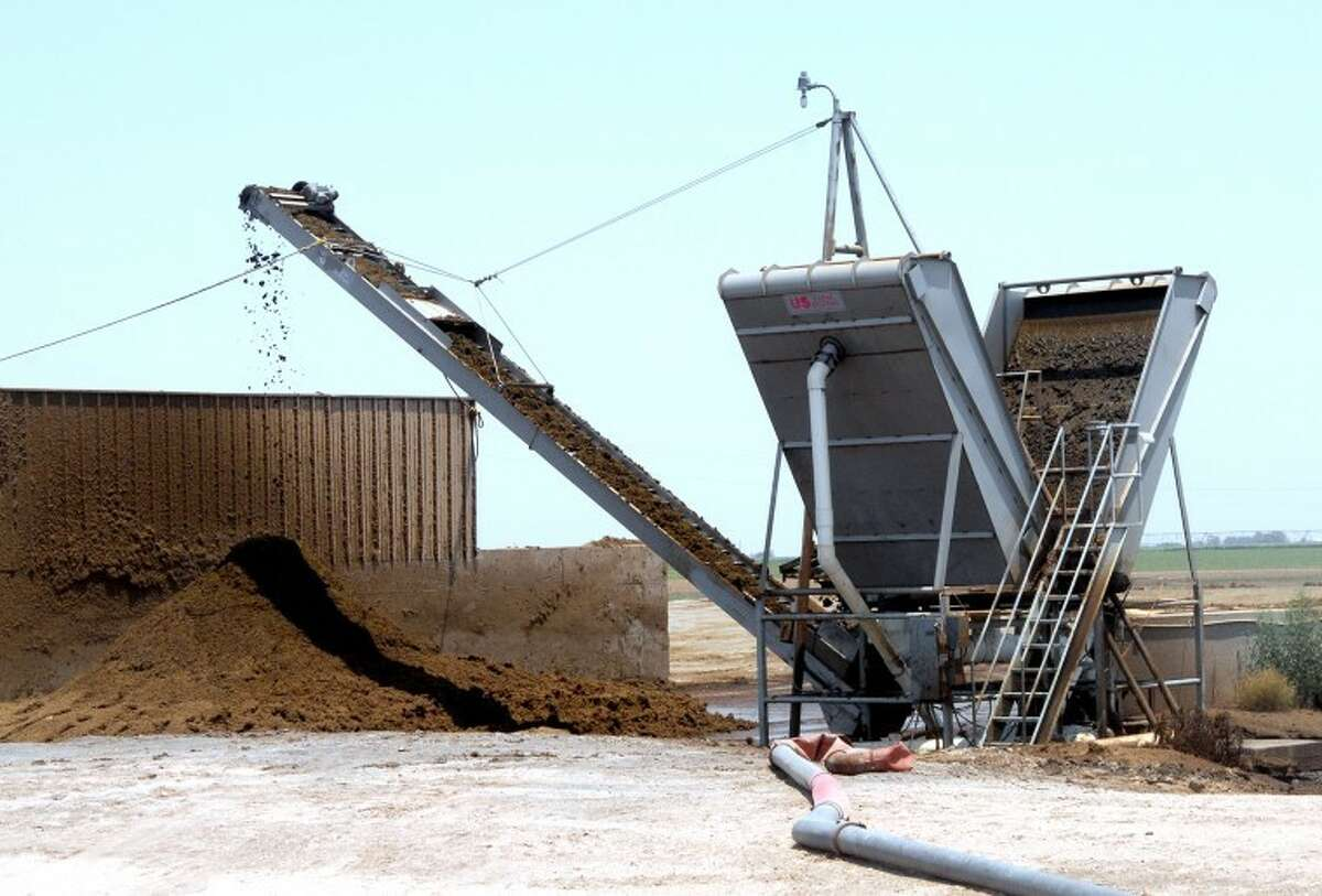 Solid waste moves through a separator as part of the recycling process at Vista Grande Dairy south of Plainview