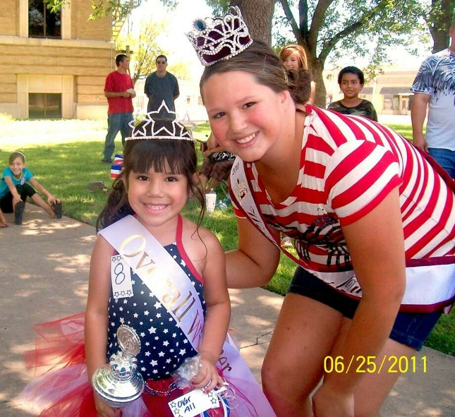 Kaitlyn Castillo, 4-year-old daughter of Fidel and Jessica Castillo of Plainview, was named Miss Firecracker at a pageant held June 26 on the lawn at the Hale County Courthouse. Here, Kaitlyn poses with the 2011 World Our Little Miss 10-12-year-old Mini Queen, Emmy Powell. Other award winners were: Most Beautiful Miss Fire Cracker, Mylie Morales, 3-year-old daughter of Veronica Morales of Plainview; and Best Red, White and Blue wear, Jaylynn Munoz, 2-year-old daughter of Jeff and Stephanie Munoz of Plainview. Divisional results were: Tiny Miss Fire Cracker, first runner-up, Jenna Martinez, 17-month-old daughter of Justin and Rina Martinez of Lockney; and Tiny Miss Firecracker Queen, Kandi Gallardo, 8-month-old daughter of Rene and Kassandra Cardova of Plainview. In the Mini Miss Fire Cracker division, first runner-up was Alexis Trevino, 4-year-old daughter of Brandon and Kayla Trevino of Plainview; and Mini Miss Firecracker Queen is Lianna Jones, 4-year-old daughter of Typhany Jones of Plainview. Directors for the Miss Firecracker Pageant are Ricky and Julie Powell. For more information regarding area pageants, call them at 806-288-0059. Photo: Courtesy Photo