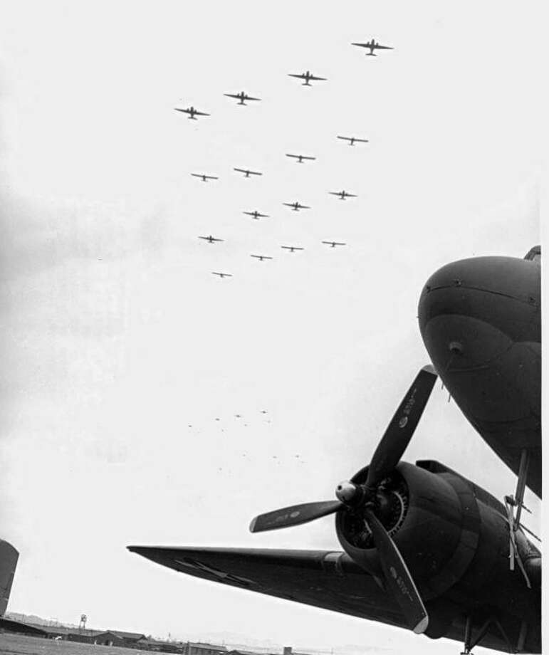 "Courtesy of Charles Day, National WWII Glider Pilots AssociationThis photo shows WACO CG-4A gliders being towed into combat by C-47s in Operation Market-Garden in Holland in September 1944. ""Boots"" King was a glider pilot in this operation and three other glider operations during World War II."