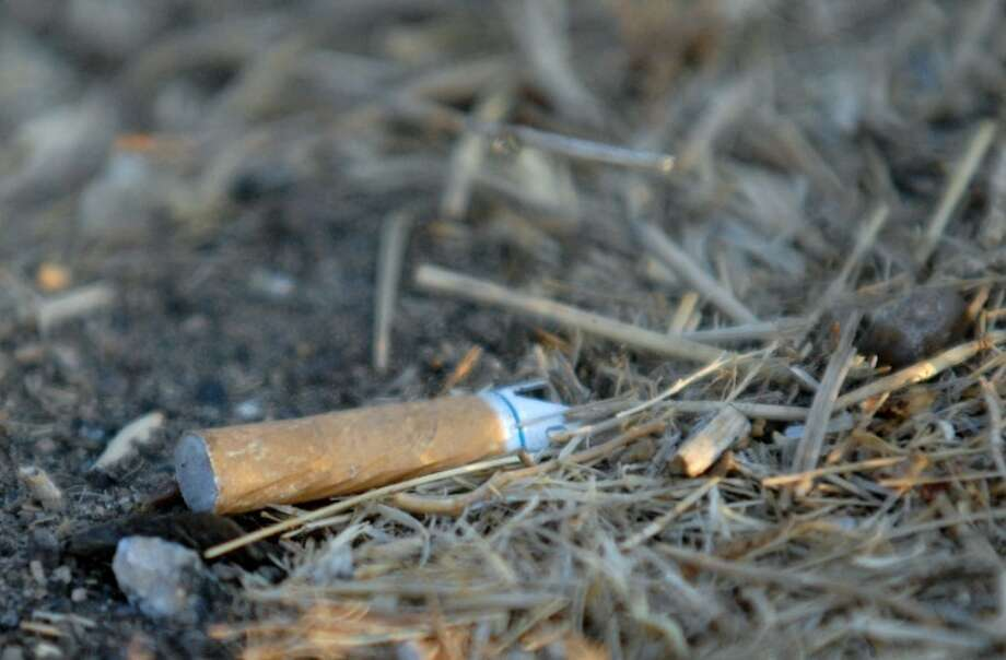 """Hale County Judge Bill Coleman said residents need to continue to be aware of the fire danger that has resulted from the ongoing drought, which includes not tossing out cigarette butts like this one found on an I-27 access road. The state has developed a public awareness campaign with the theme """"Texas is Not Your Ashtray"""" in which they point out that carelessly-discarded cigarettes can cause fires that quickly spread through dry grass along the side of the roads and then into dry fields."""