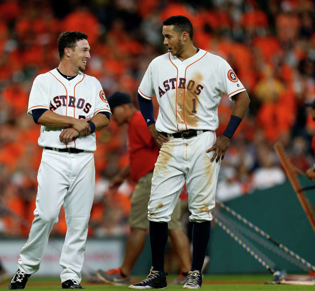 Houston Astros third baseman Alex Bregman (2) chats with shortstop Carlos Correa (1) after his flyout ending the sixth inning of an MLB game at Minute Maid Park, Monday, July 25, 2016, in Houston.