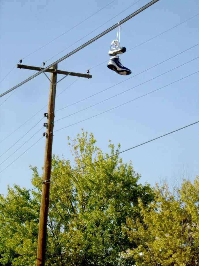 Exactly how theygot there we're not sure, but what appeared to be a nice pair ofNike athletic shoes were found hanging on a powerline along NinthStreet near the downtown area on Thursday afternoon. A shoe sizewas not immediately available.