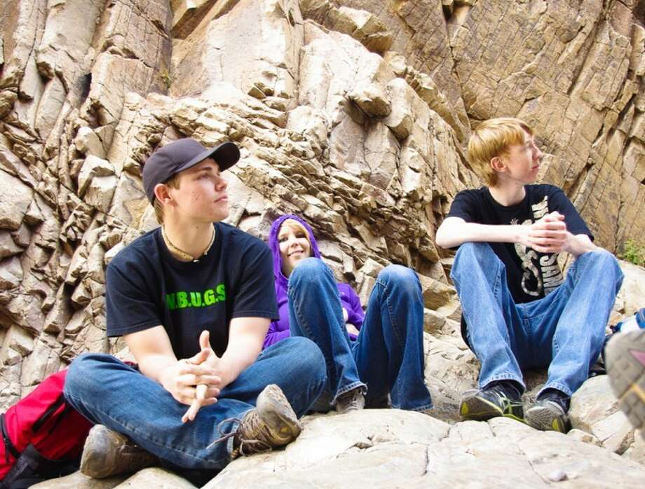 Wayland Baptist University PhotoWayland students Hunter Green (left), Jodie Schumacher and Jacob Kemmer take a break during a recent study trip. Wayland's School of Mathematics and Sciences sponsors several trips a year to give students practical experience to supplement classroom study.