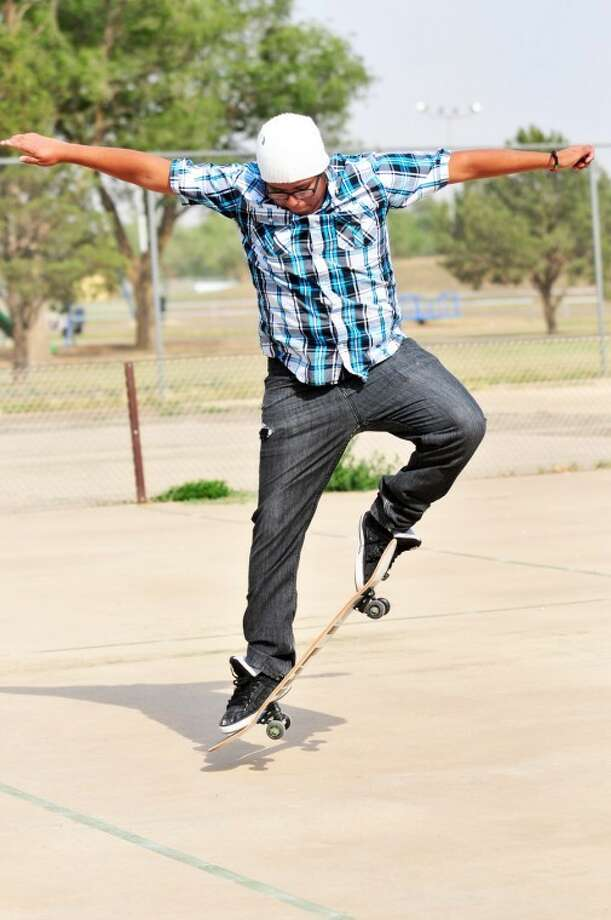 Local skater and recent PHS graduate Zeke Solorzano practices tricks at Runningwater Draw Park.