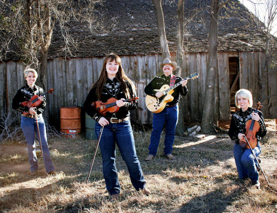 Texas Stardust, a four-piece band specializing in traditional Texas fiddle and dance music, includes guitarist Daron Brown of Plainview (second from right), and will celebrate the release of its new CD, at 7 p.m. Saturday at the Lone Star Cowboy Church, 1309 E. FM 1585 in Lubbock. Other members include Tracy Bohn (left), Kalli Burk and Stacy Bohn, all of Lubbock. Photo: Courtesy Photo