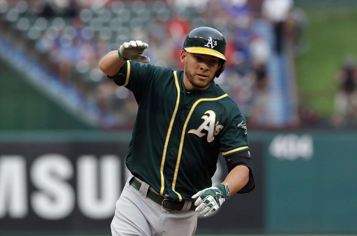Danny Valencia #26 of the Oakland Athletics runs the bases after a two-run homerun against the Texas Rangers in the first inning at Globe Life Park in Arlington on July 25, 2016 in Arlington, Texas.