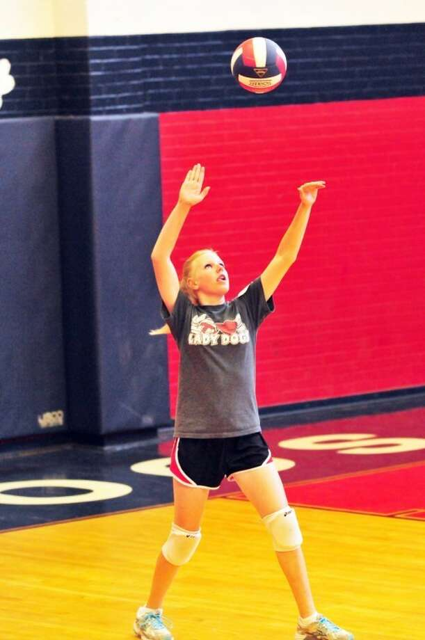 Kaci Matthews serves up the ball in a scrimmage at the end of day one at the Plainview High School volleyball camp. Photo: Summer Morgan/Plainview Herald