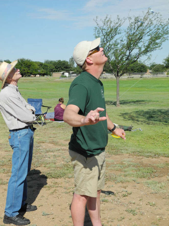 Hale County Assistant DA Chris Brown and Plainview Bible Church member Tom King keep an eye on their kites at the Back to School Kite Flying at College Hill Elementary School on Saturday. Photo: Gail M. Williams | Plainview Herald