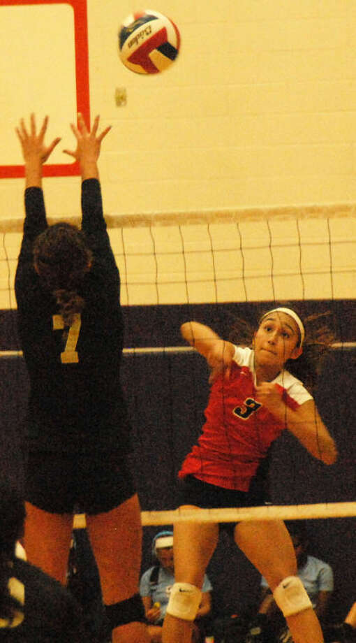 Plainview's Lupita Quintanilla (3) follows through on a hit over an opponent's attempted block during a match at the Granbury Tournament Saturday. Photo: Doug McDonough/Plainview Herald