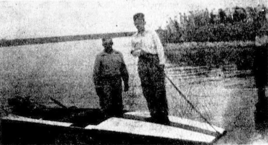Tule Lakeconcessionaire W.W. Spiller and his son, Billy Wade, show one ofthe new passenger boats available for rent in 1941. Photo: Tulia Herald Photo